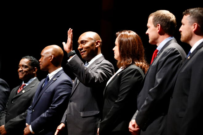 Lee Harris, center, waves at the swearing in ceremony for Shelby County officials elected August 2. Harris, 39, will officially take over Shelby County mayoral duties on Saturday.