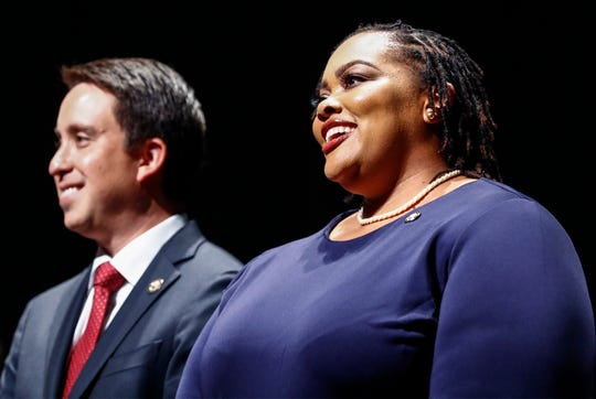 Tami Sawyer, right, Michael Whaley wait to be sworn in as Shelby County Commissioners during a ceremony on Aug. 27 at the Cannon Center of the Performing Arts in Memphis.