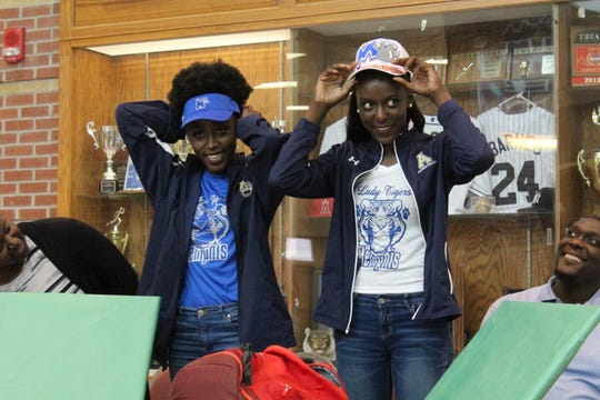 Arlington stars Lanyce, left, and Lanetta Williams announce their verbal commitment to the Memphis Lady Tigers on Thursday.