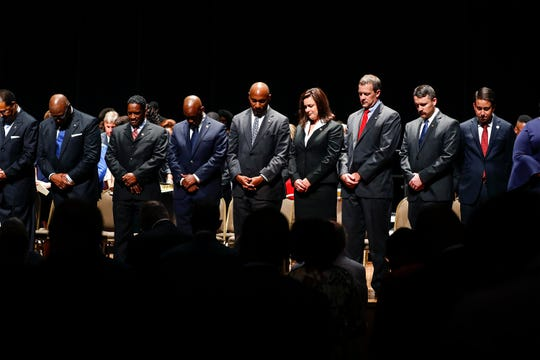 New Shelby County Mayor Lee Harris (middle) and new Shelby County Commissioners wait to be sworn in during a ceremony Thursday afternoon at the Cannon Center of the Performing Arts in Memphis.