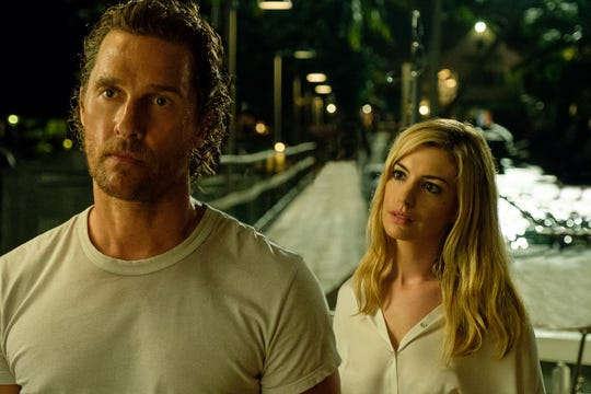 "Anne Hathaway (right) complicates ex-husband Matthew McConaughey's world in ""Serenity."""