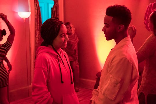"""Amandla Stenberg (left) and Algee Smith share a happier moment in """"The Hate U Give."""""""