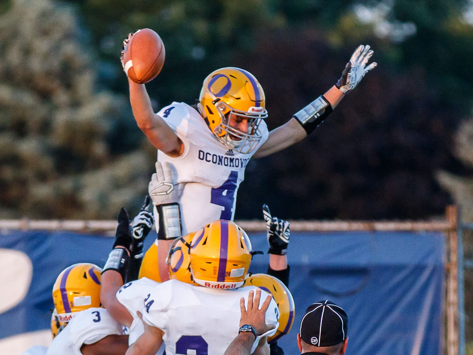 Oconomowoc receiver Ethan Burch (4) is hoisted by teammates after a 36-yard touchdown reception during the game at Brookfield Central on Thursday, August 23, 2018.