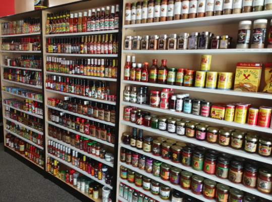 Flavorings from mild to burning hot fill shelf after shelf at the newly opened Just Not Salt & Pepper in Greenfield.