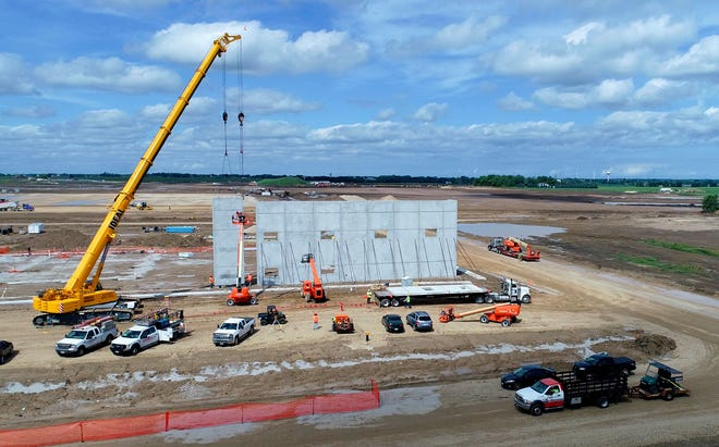 A crane erects a structure on the Foxconn site just north of First Street and west of Racine County Road H as construction is underway for Foxconn Technology Group's planned $10 billion electronics factory complex in Mount Pleasant.
