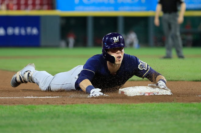 CINCINNATI, OH - AUGUST 29:  Christian Yelich #22 of the Milwaukee Brewers  slides into third base for a tripple in the 7th inning against the Cincinnati Reds at Great American Ball Park on August 29, 2018 in Cincinnati, Ohio.  (Photo by Andy Lyons/Getty Images)