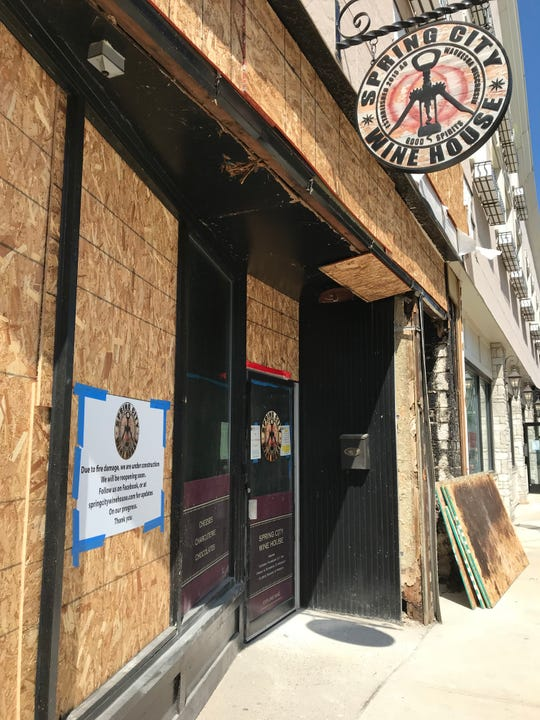 Spring City Wine House, one of the businesses damaged in the Aug. 14 fire at the Clarke Hotel in downtown Waukesha, awaits a complete facade renovation along West Main Street. Inside, work also continues to correct smoke, fire and water damage.
