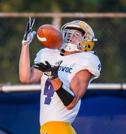 Oconomowoc receiver Ethan Burch (4) pulls in a 36-yard touchdown reception during the game at Brookfield Central on Thursday, August 23, 2018.