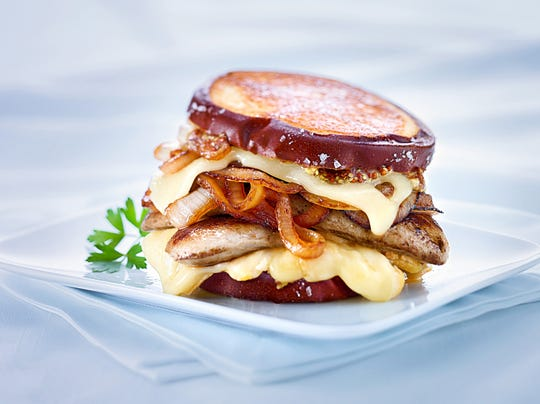 The Limburger Leap sandwich layers the cheese with a butterflied bratwurst and beer caramelized onions.