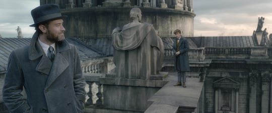 """A younger Albus Dumbledore (Jude Law, left) has New Scamander's (Eddie Redmayne) back in """"Fantastic Beasts: The Crimes of Grindelwald."""""""