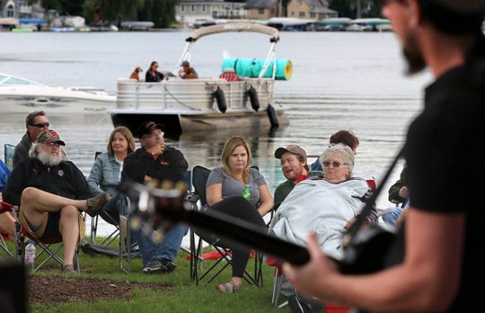 People on and off shore listen to a performance during a past Waterfront Wednesday concert. This year's summer concert series on the Pewaukee lakefront kicks off June 5.
