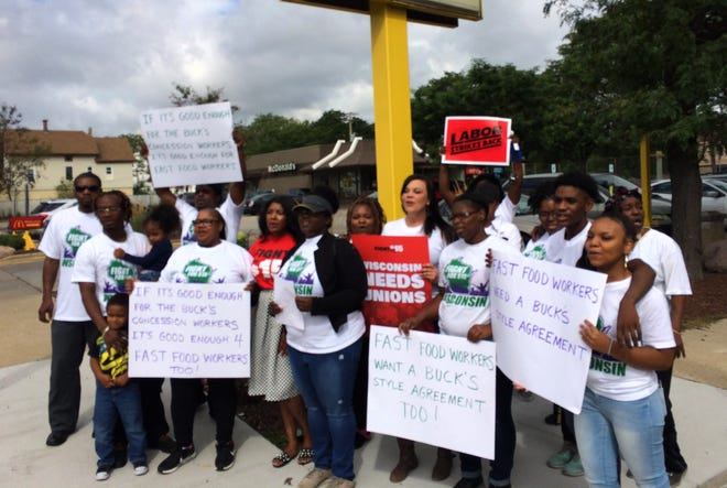 """The """"Fight for $15"""" campaign and the Milwaukee Area Service and Hospitality Workers Organization held a brief media event and rally in front of a McDonald's restaurant Thursday ."""