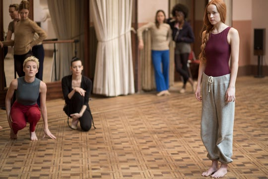 "Dakota Johnson (right) plays a dancer who joins a dark, dark ballet academy in ""Suspiria."""