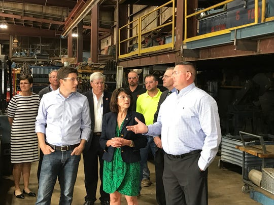 Republican U.S. Senate candidate Leah Vukmir (center) and House candidate Bryan Steil listen to Jason Young (right), president of Price Erecting, during a tour of the facility Thursday.