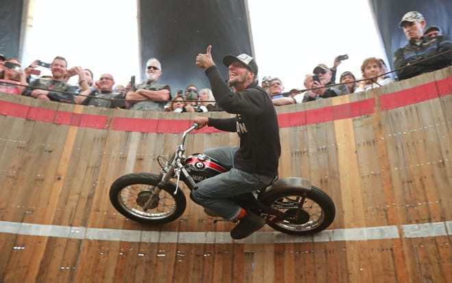 "Rhett ""Rotten"" Giordano rides a SX175 Harley-Davidson dirt bike on the Wall of Death during the Moto-Carnival, part of the Harley-Davidson 115th anniversary party at Veterans Park."
