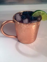 Blueberry simple syrup lends a unique flavor to this version of the Moscow mule.