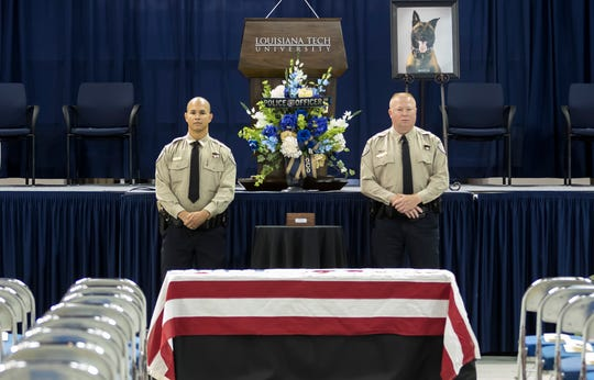 Lincoln Parish Sheriff's deputies stand guard over the box of ashes containing sergeant Boco, a Lincoln Parish K-9 deputy who was killed in the line of duty while pursuing a suspect on August 17, during a funeral service for the K-9 deputy at the Thomas Assembly Center at Louisiana Tech University in Ruston, La. on August 30.