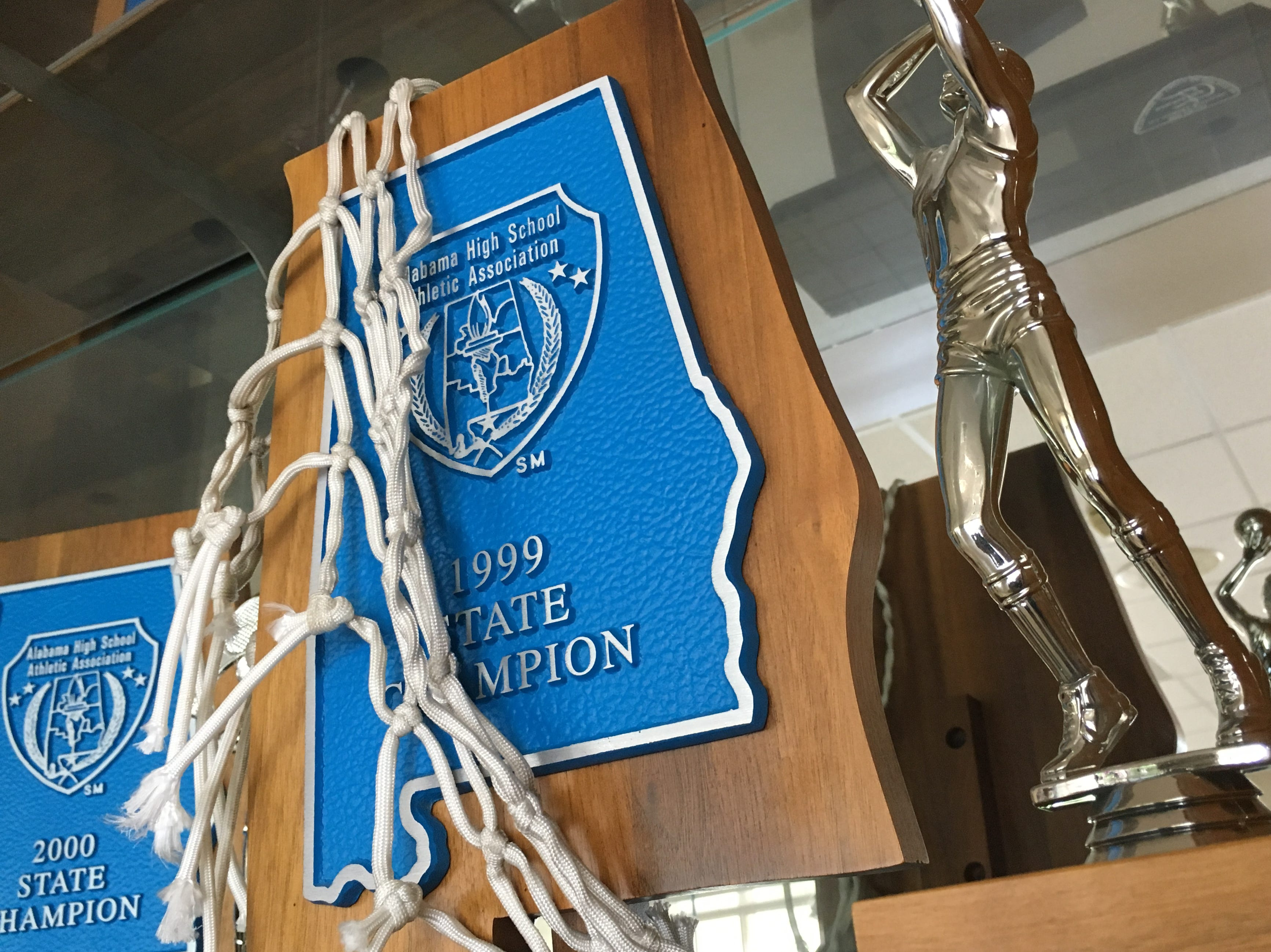 Trinity's 1999 state basketball championship trophy.