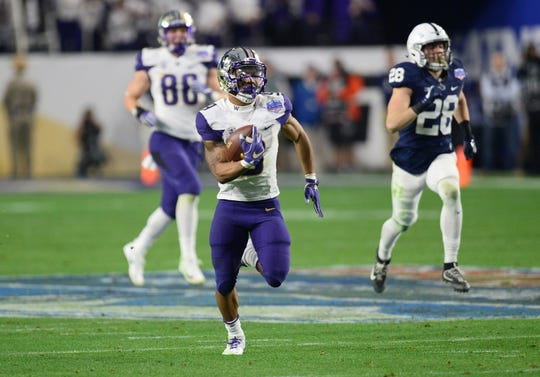 Washington running back Myles Gaskin (9) runs for a touchdown against Penn State in the Fiesta Bowl on Dec. 30, 2017, in Glendale, Ariz.