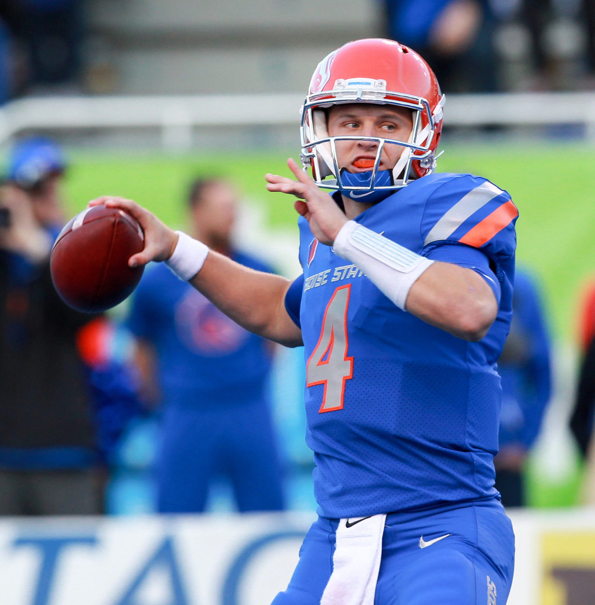 Boise State quarterback Brett Rypien looks to pass against Virginia during a game last season.  Brian Losness/USA TODAY Sports Sep 22, 2017; Boise, ID, USA; Boise State Broncos quarterback Brett Rypien (4) throws the ball during the first half against the Virginia Cavaliers at Albertsons Stadium. Mandatory Credit: Brian Losness-USA TODAY Sports