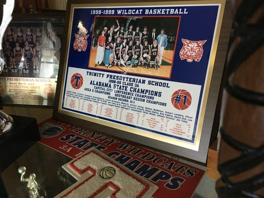 A display at Trinity about the school's 1999 state championship boys basketball team.