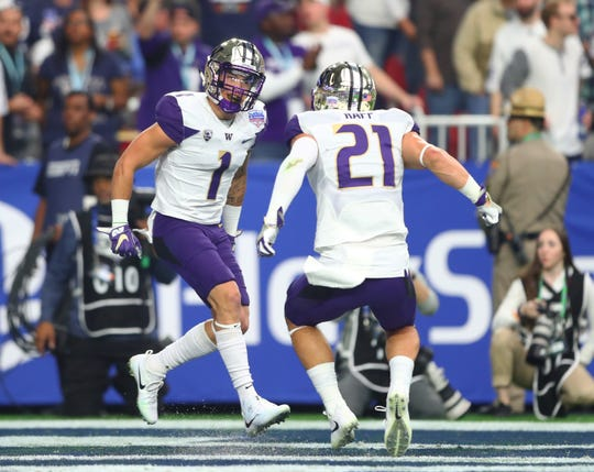 Washington defensive back Byron Murphy (1) celebrates a first quarter interception with teammate Taylor Rapp (21) in the Fiesta Bowl against Penn State on Dec. 30, 2017, in Glendale, Ariz.