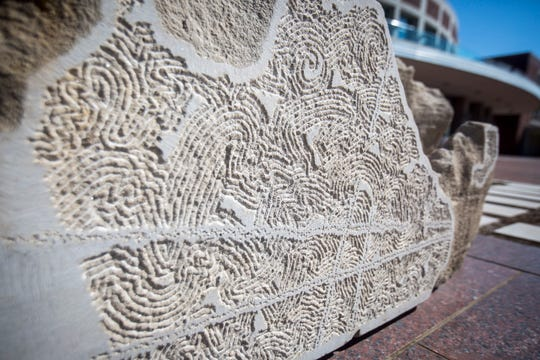 Limestone sculptures by Bloomington artist Dale Enochs flank the new plaza in front of Emens Auditorium. Locally, his art also can be found at the Muncie Children's Museum playground and at the entrance to the Atrium Gallery in the Art and Journalism Building at Ball State.