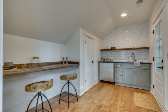 The living space over the garage offers a bedroom, bathroom and this kitchen and eating space.