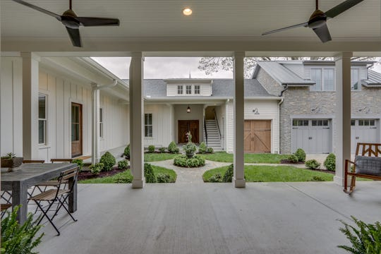 The home wraps around a beautifully designed courtyard that is visible from almost every room in the home.