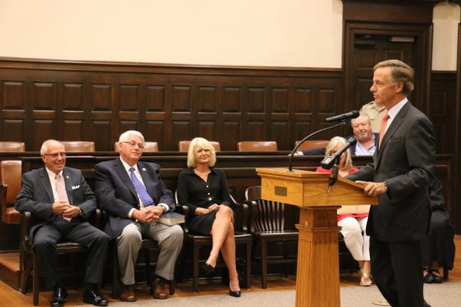 Gov. Bill Haslam talks before swearing in Sheriff Jeff Long, Mayor Rogers Anderson and Trustee Karen Paris on Aug. 30, 2018.