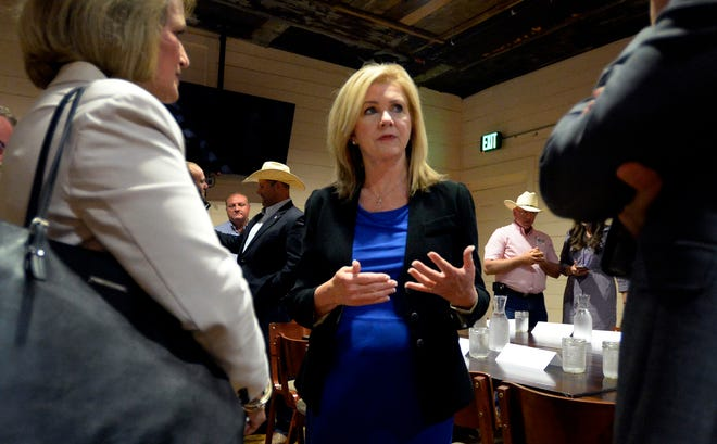U.S. Rep. Marsha Blackburn talks with members of the agriculture community Friday, August 24, 2018, in Nashville, Tenn. Blackburn is the Republican candidate in the U.S. Senate race.