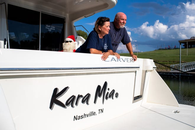 Ron and Karen Atkisson pose for a portrait on their boat, on which they recently completed over 7,000 miles on America's Great Loop, during a stopping point at the Clarksville Marina on Aug. 28, 2018, in Clarksville, Tenn. The loop took them to the Gulf of Mexico, up the Atlantic Coast and across the Great Lakes back to their starting point of Nashville.