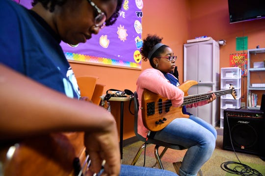 Taryn Morrow, 10, already is familiar with the piano and is now learning to play the bass at the Music Takes you Places program Wednesday Aug. 1, 2018, in Smyrna, Tenn.
