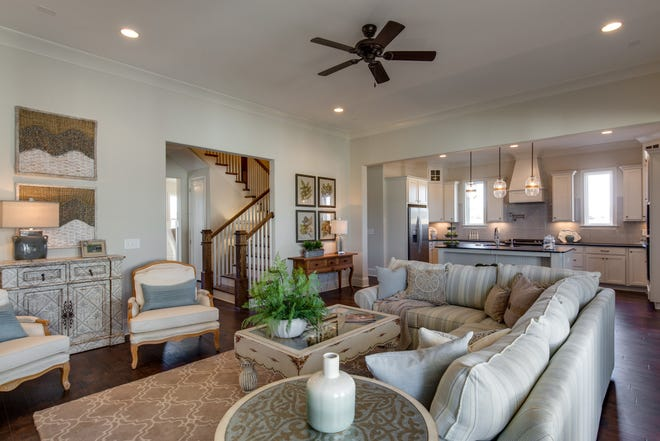 Living rooms and kitchens flow together in today's new homes, creating a convenient space for family activities and entertaining. This is a house by Celebration Homes in Durham Farms.