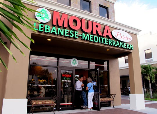 Moura Bistro owner Nabil Bassil greets guests June 11, 2016, at the door of his Lebanese restaurant in Meridian Marketplace in North Naples.