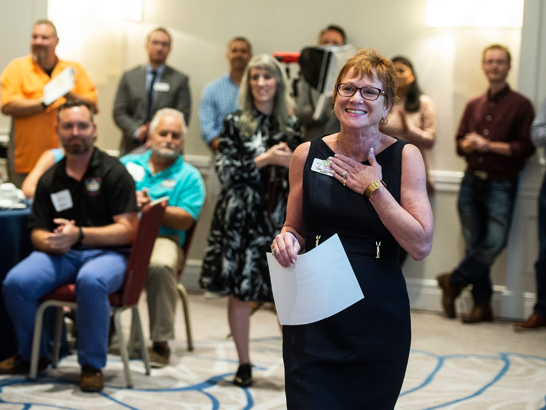 Trish Leonard reacts to getting the small business of the year award during the Bonita Springs Area Chamber of Commerce Awards Luncheon at the Hyatt Regency Coconut Point in Estero on Thursday, Aug. 30, 2018.