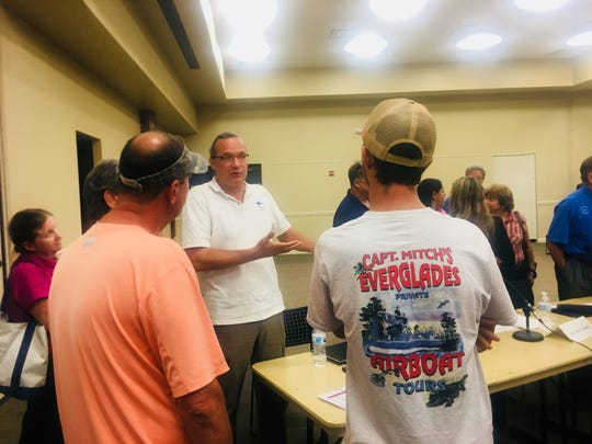 Vincent Lovko, a scientist from the Mote Marine Laboratory in Sarasota, speaks to Southwest Florida fishing guides about red tide at Collier County's forum Wednesday night, Aug. 29, 2018.