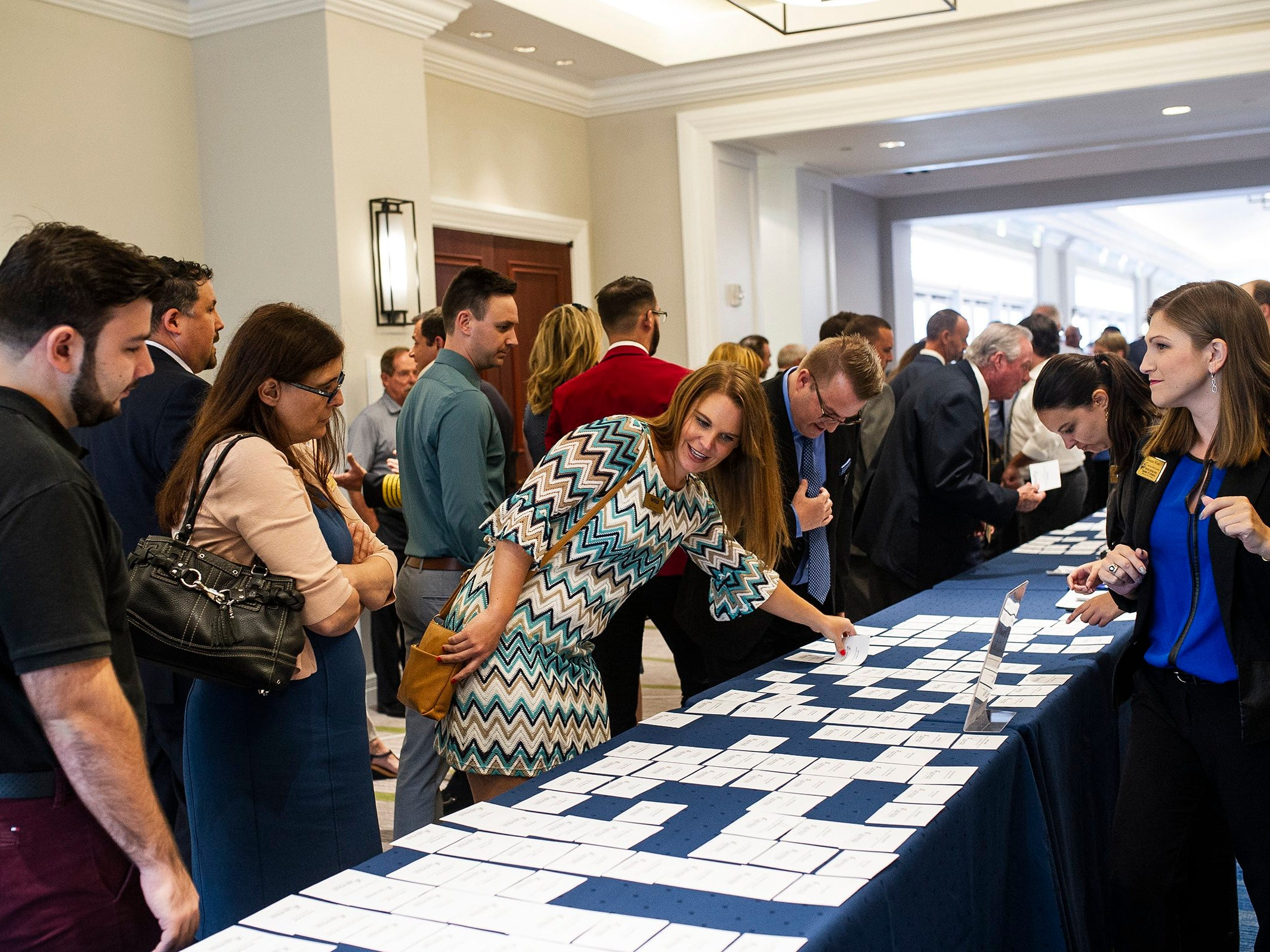 Members check in during the Bonita Springs Area Chamber of Commerce Awards Luncheon at the Hyatt Regency Coconut Point in Estero on Thursday, Aug. 30, 2018.