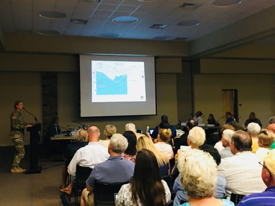 Lt. Col. Jennifer Reynolds of the Army Corps of Engineers speaks to the audience during Collier County's red tide forum Wednesday night, Aug. 29, 2018.