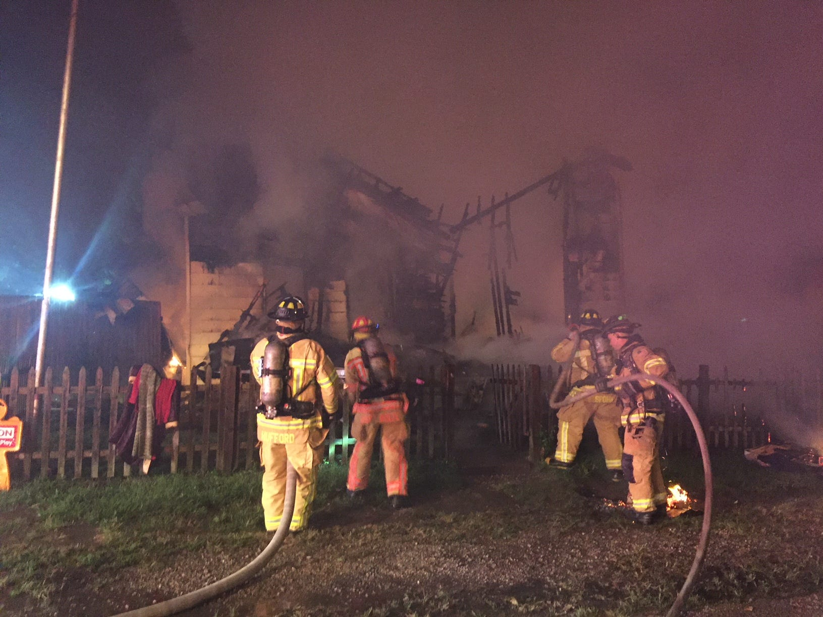 Firefighters battle a blaze at 176 E. Channel St. early Thursday morning. A body was found at the site.