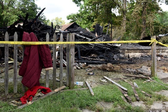 Some clothes and a knit blanket on the fencing around the scene of a fire on Thursday, Aug. 30, 2018 at 176 E. Channel St. The fire, which resulted in the destruction of the home, was reported at 3:11 a.m. on Thursday. A body was found at the scene of a person believed to be a middle age man. He has been takenÊto the Licking CountyÊCoroner's Office to be identified.Ê
