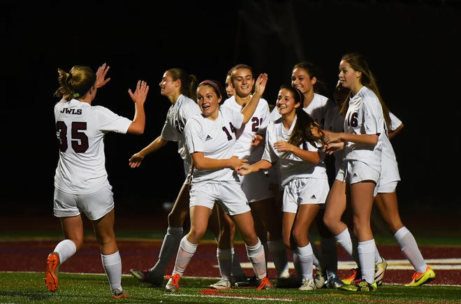 Dana DiBella (No. 7, center) of Park Ridge, here being congratulated by teammates, is among the veterans being  counted on to lead the Owls girls soccer team in 2018.