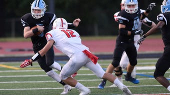 Mahwah QB Kyle Teel with a 22 yard touchdown run against Wallington in T-Birds tri-scrimmage Wednesday. Hasbrouck Heights was other team competing.