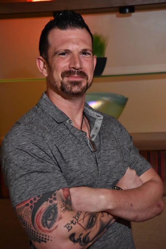 Jonathan Perzley of Sportstars agency, poses for a photo