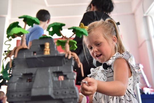 Kenzie Cameron, 5, plays with toys at Walmart's holiday day event in New York, NY.