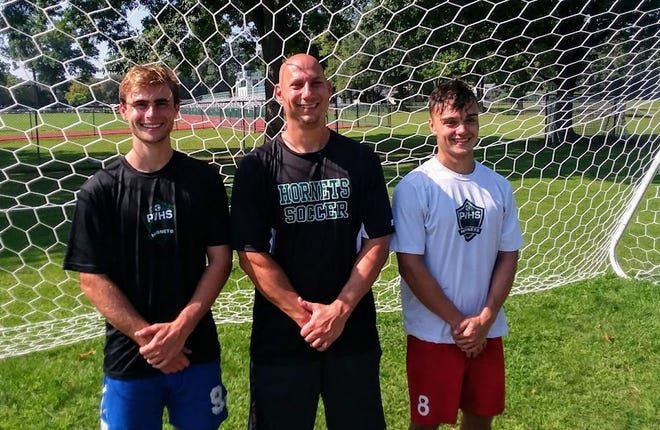 Passaic Valley boys soccer coach Mike Couden, flanked by team captains David Zambrano (left) and Patrick Lettre.