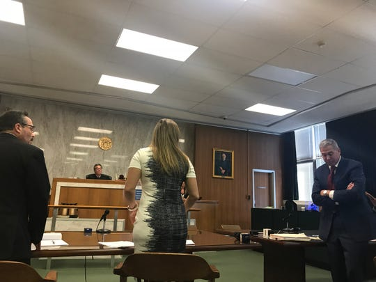 (L-R) Philip Espinosa, attorney for the state Department of Transportation, plaintiff and attorney Jacqueline Rosa and Brian Chewcaskie, Leonia's borough attorney, face Judge Peter Bariso in Hudson County Superior Court on Thursday, August 30.