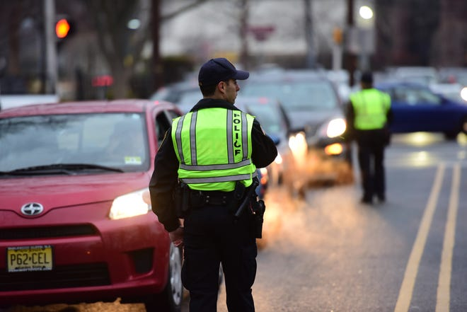 Leonia Police Officer John Longo on patrol on Station Parkway.  Leonia Police are stopping non-residents from using side streets during rush hour to alleviate traffic to residents.