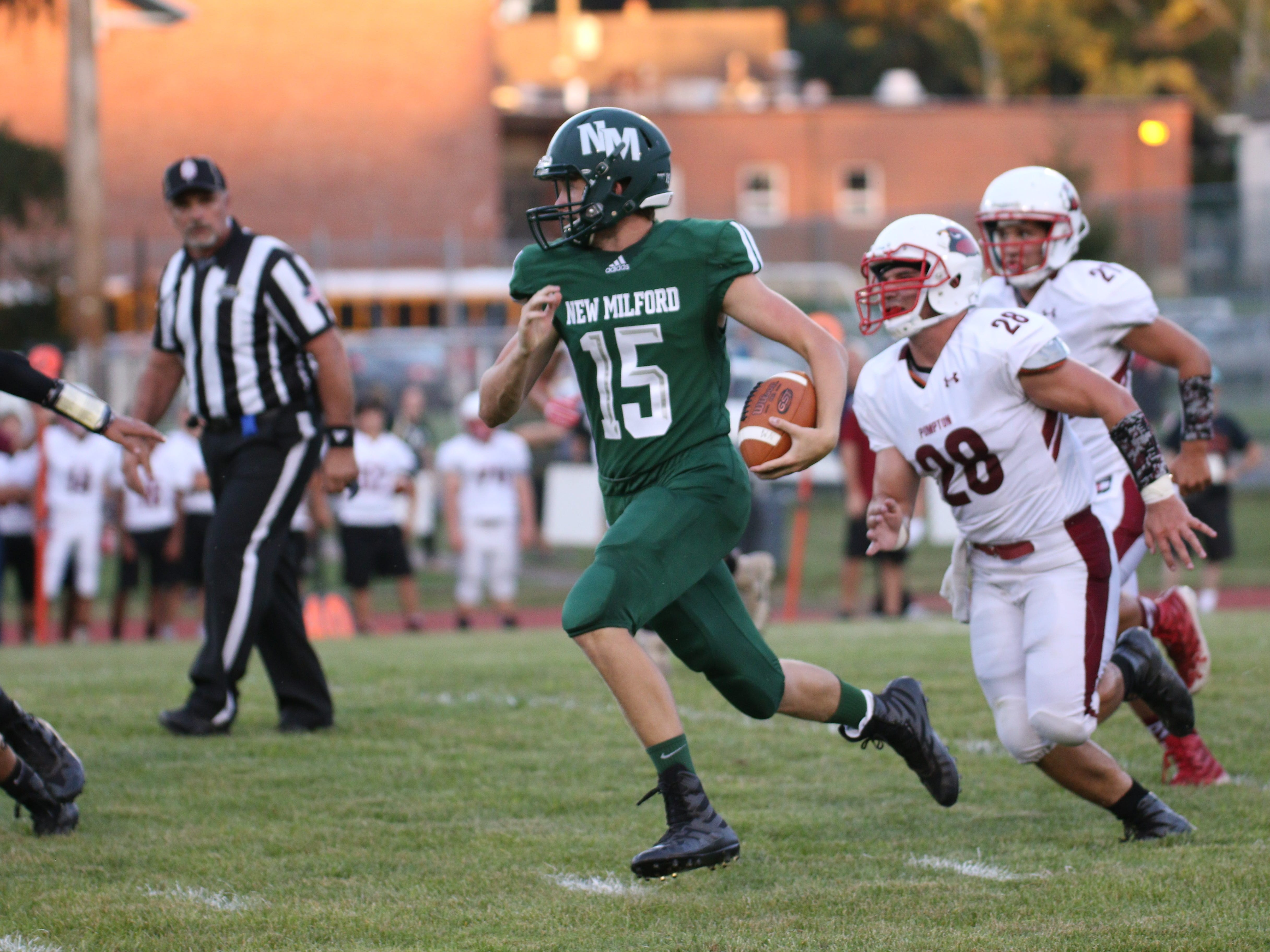 New Milford senior quarterback Brian Mackey looking for yardage against Pompton Lakes in an NJIC North Liberty Division game on opening day of high school football on Thursday, Aug. 30, 2018.