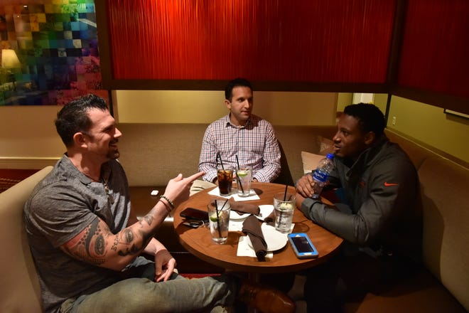Sports agents Jonathan Perzley and Jerard Roggio, meet with their client JC Jackson of the New England Patriots in Renaissance Hotel in Elizabeth, NJ, on Wedensday, August 29.